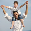 Happy father and son have fun and enjoy time on beach — Stock Photo #5743659