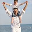 Happy father and son have fun and enjoy time on beach — Stock Photo #5744380