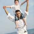 Happy father and son have fun and enjoy time on beach — Stock Photo #5745892
