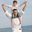 Happy father and son have fun and enjoy time on beach — Stock Photo #5745899