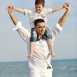 Happy father and son have fun and enjoy time on beach — Stock Photo #5745906