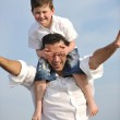 Happy father and son have fun and enjoy time on beach — Stock Photo #5745927