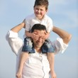 Happy father and son have fun and enjoy time on beach — Stock Photo #5745951