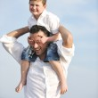 Happy father and son have fun and enjoy time on beach — Stock Photo #5745981