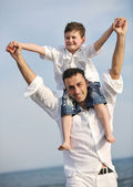Happy father and son have fun and enjoy time on beach — Stock Photo