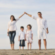 Happy young family have fun on beach — Stock Photo #5751027