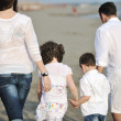 Happy young family have fun on beach — Stock Photo #5751364