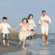Happy young family have fun on beach — Stock Photo #5753751