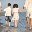 Happy young family have fun on beach — Stock Photo #5753780
