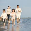 Happy young family have fun on beach — Stock Photo #5753878