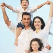 Happy young family have fun on beach — Stock Photo #5770111