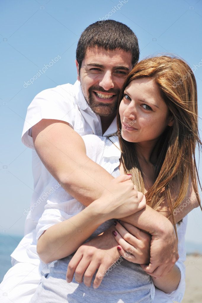 Happy young couple have fun and romantic moments on beach at summer season and representing happynes and travel concept  Stock Photo #5781382