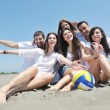 Group of happy young in have fun at beach - Stock Photo