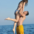 Happy young couple have romantic time on beach — Stock Photo #5825839