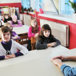 Happy kids with  teacher in  school classroom — Stock Photo