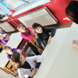 Stock Photo: Happy kids with teacher in school classroom
