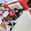 Happy kids with  teacher in  school classroom - Foto Stock