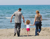 Happy young family have fun on beach — Stockfoto