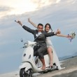 Just married couple on the beach ride white scooter — Stock Photo #5840748