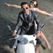 Just married couple on the beach ride white scooter — Stock Photo #5841712