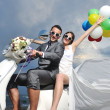 Just married couple on the beach ride white scooter — Stock Photo #5842871
