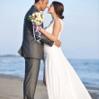Romantic beach wedding at sunset — Stock Photo #5846049