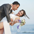 Romantic beach wedding at sunset — Stock Photo #5846552
