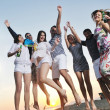 Group of young enjoy summer party at the beach — Stock Photo #5846578