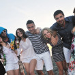 Group of young enjoy summer party at the beach — Stock Photo #5846640