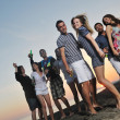 Group of young enjoy summer  party at the beach - Stock Photo