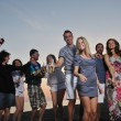 Group of young enjoy summer party at the beach — Stock Photo