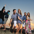 Group of young enjoy summer party at the beach — Stock Photo #5847559