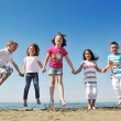 Happy child group playing  on beach - Foto Stock