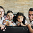 Happy young family have fun and working on laptop at home — Stock Photo #5857138