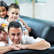Happy young family have fun and working on laptop at home — Stock Photo #5857259