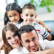 Happy young family have fun and working on laptop at home — Stock Photo #5857339
