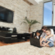 Happy young family have fun and working on laptop at home — Stock Photo #5858110