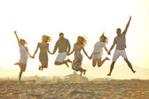 Happy young group have fun on beach — Stok fotoğraf