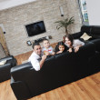 Happy young family have fun and working on laptop at home — Stock Photo #5860151