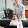 Happy young couple have fun in modern kitchen — Stock Photo #5860216
