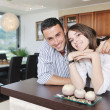 Happy young couple have fun in modern kitchen — Stock Photo #5861460