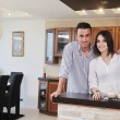 Happy young couple have fun in modern kitchen — Stockfoto