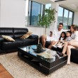 Family wathching flat tv at modern home indoor — Foto Stock