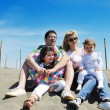 Happy young family have fun on beach — Stock Photo #5865030