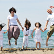 Happy young family have fun on beach — Stock Photo #5865225