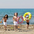 Stock Photo: Child group have fun and play with beach toys