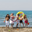 Happy child group playing on beach — Stock Photo #5866764