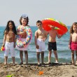 Child group have fun and play with beach toys — Stock Photo #5866901