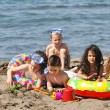 Child group have fun and play with beach toys — Stock Photo