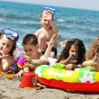 Child group have fun and play with beach toys — Stock Photo #5867139